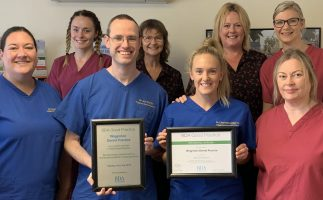 Wigginton Dental Practice team holding BDA good practice award